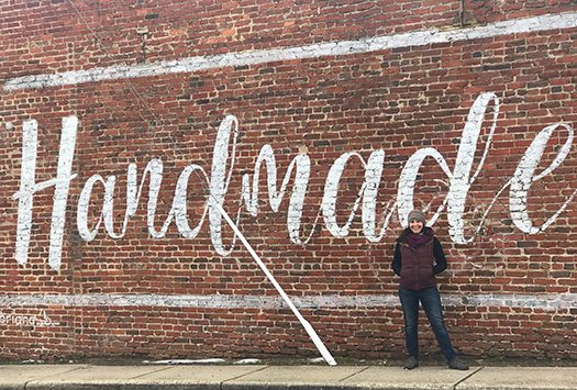 "Amanda in front of ""Handmade in Hyattsville"" mural"